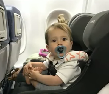 Baby-kicked-off-plane.png